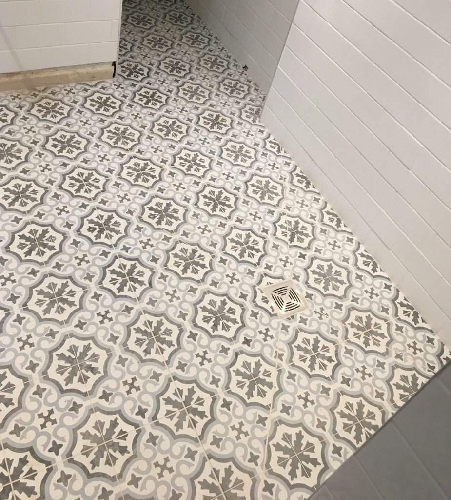 Heritage-style tiles in the wet room downstairs bathroo